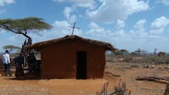 Garbicha's community church is made of mud and branches from the savannah