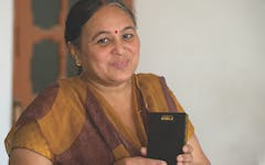 Preeti, and Indian woman, holding a Talking Bible