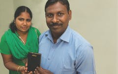 Pastor Ram and his wife holding a Talking Bible.