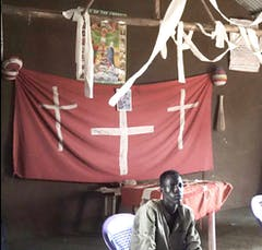 A picture of the church decorated with a red sheet and toilet paper.