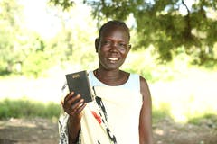 Rebecca smiles and holds up her Talking Bible
